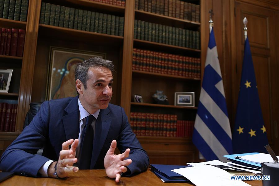 Greek Prime Minister Kyriakos Mitsotakis speaks during an interview in Athens, Greece, Oct. 30, 2019. (Xinhua/Marios Lolos)
