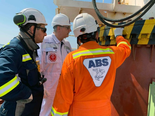 ABS Chairman, President and CEO, Christopher J. Wiernicki on board a vessel with ABS surveyors.